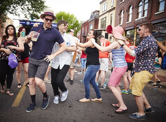 "An impromptu conga line at Cherokee Street's Cinco de Mayo celebration -- an event whose free-wheeling spirit typifies the ""New Cherokee"" evident at the St. Louis Swap Meet. - PHOTO BY STEVE TRUESDELL"