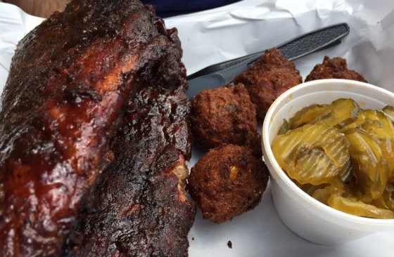 "Dalie's full rack of ribs, shown here with a side of hush puppies and ""Fire and Ice Pickles"" - PHOTO BY SARAH FENSKE"