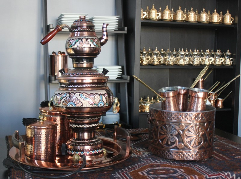 Coffee has its own special set up. The serving pots for tea can be seen on a shelf behind it. - SARAH FENSKE