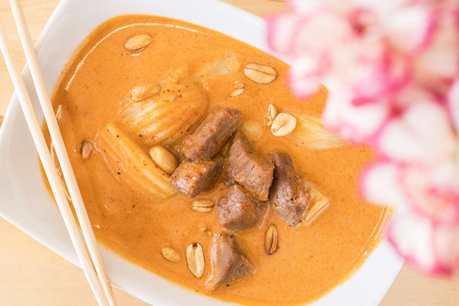 Massaman beef is slow-cooked in curry sauce with coconut milk, peanuts, potatoes and white onions. - MABEL SUEN