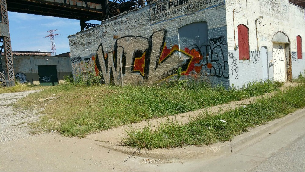 "Graffiti artists ""bombed"" the city, Harrington says, with vandalism like that depicted above. - PHOTO BY JOHN HARRINGTON"