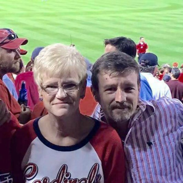 Chris Sanna was shot in the back on Friday after celebrating the birthday of his mom, Candis Sanna, left, at a St. Louis Cardinals game. - IMAGE VIA FACEBOOK