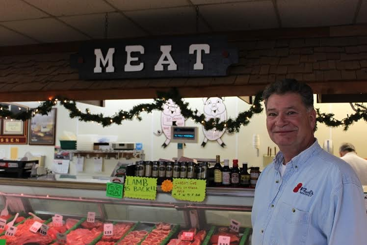 Gary Crump is the second-generation owner of Paul's Market in Ferguson. - COURTESY OF PAUL'S MARKET