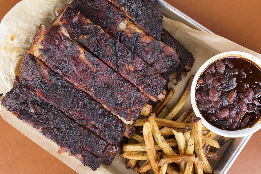 A full rack of spare ribs with hand-cut fries and pit beans. - MABEL SUEN