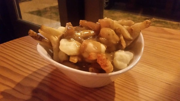 The classic poutine features a rich, brown gravy and, of course,  cheese curds. - PHOTO BY KATIE INEICH