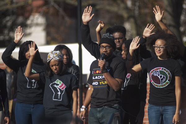 """How Mizzou responds to the threat on Black lives today will dictate the progress of the school for the next 10+ years,"" grad student Jonathan Butler, center, tweeted on November 11. - PHOTO BY NICK SCHNELLE/THE COLUMBIA TRIBUNE"