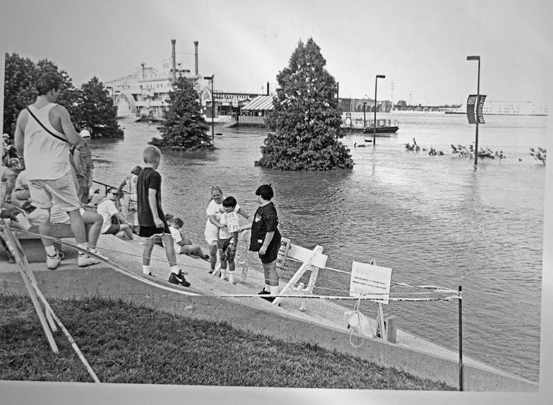Children on the steps of the Gateway Arch — suddenly riverfront property. - PHOTO BY BRIAN CHILSON