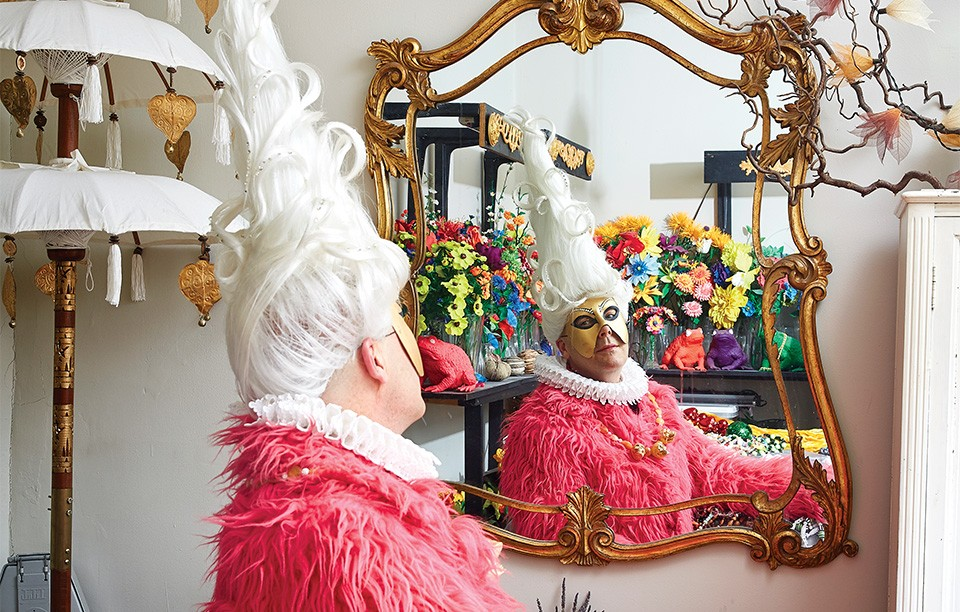 Auntie M, photographed here in his Southwest Garden flat, is among Soulard Mardi Gras' most iconic personalities. - THEO WELLING