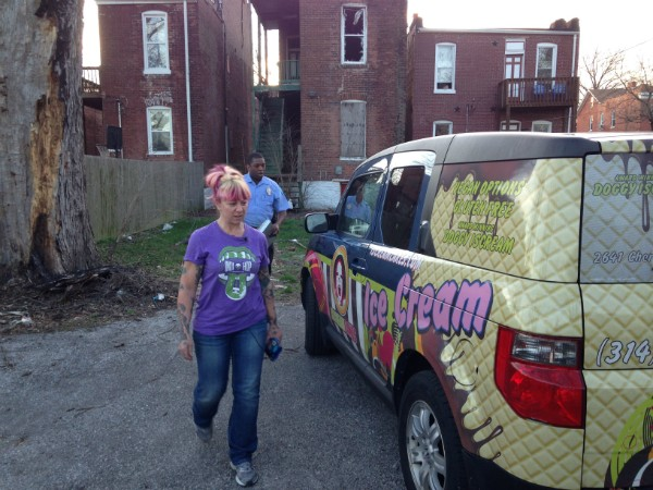 Kerry Soraci and a St. Louis police officer survey her 'I Scream' truck for damage on Thursday. - DOYLE MURPHY