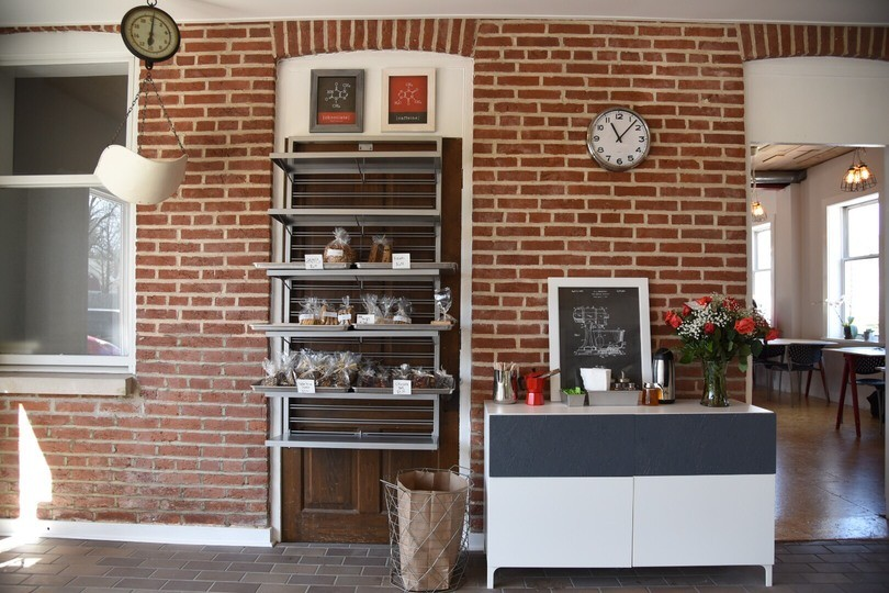 The bakery's space is charming, with exposed brick. - PHOTO BY KEVIN KORINEK