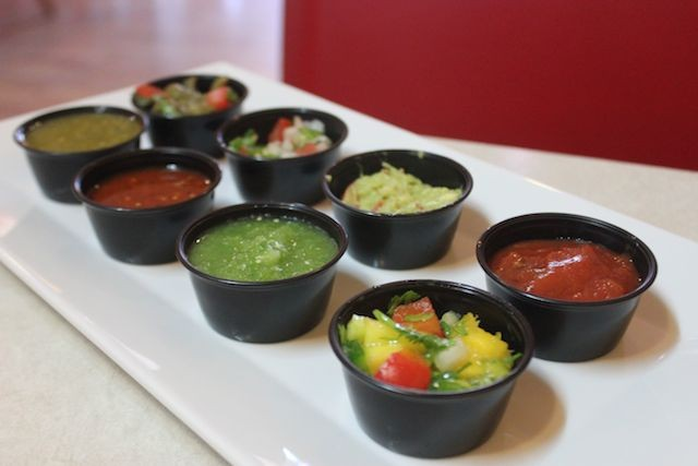 Salsas include a verde, an onion-and-habanero, and a mango salsa, studded with tomato and jalapeno. - PHOTO BY SARAH FENSKE