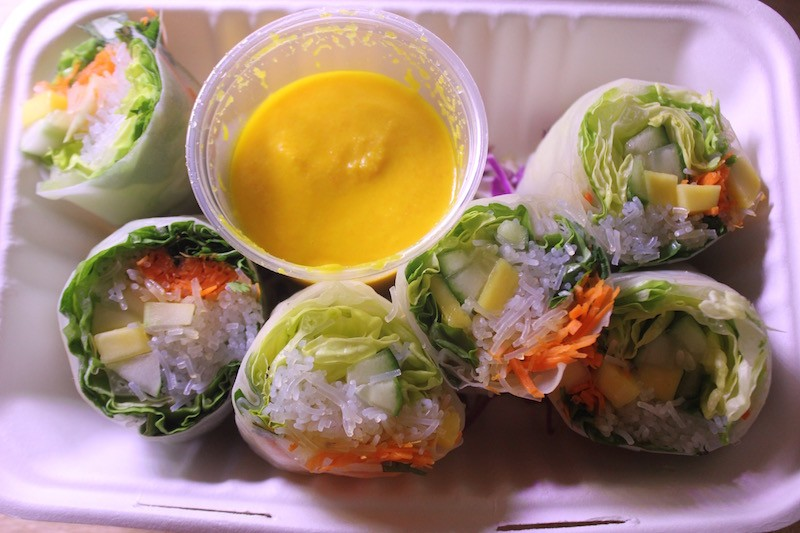Spring rolls are packed with fresh vegetables and come with a carrot-sesame sauce. - PHOTO BY SARAH FENSKE