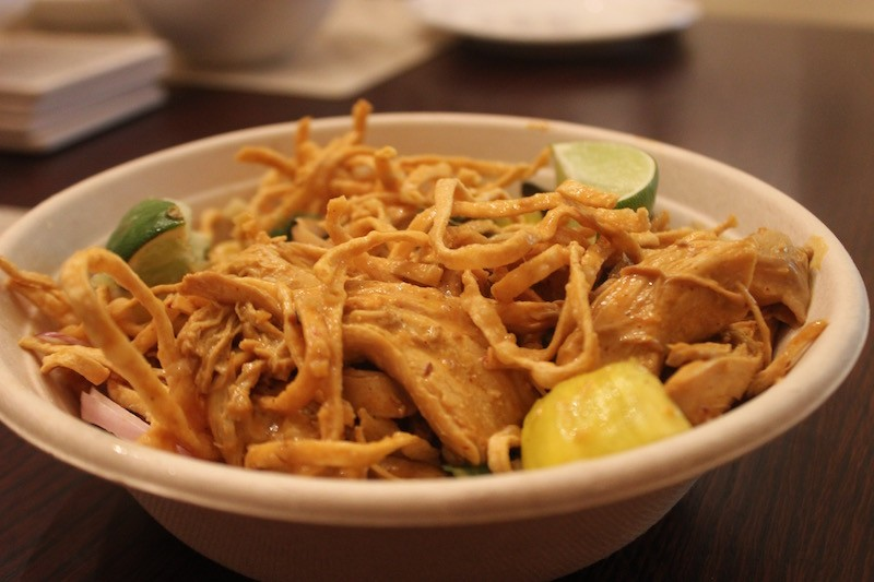 The Khao Soi chicken curry is loaded with fried egg noodles and hunks of flavorful chicken. - PHOTO BY SARAH FENSKE