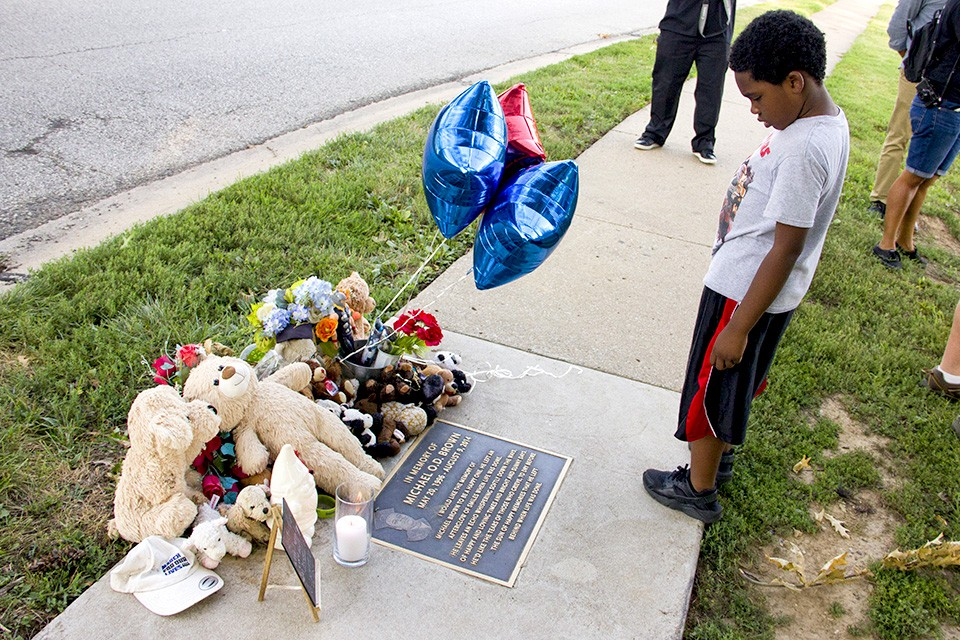 Visit Michael Brown's memorial to pay your respects to the slain teen who launched a national movement. - DANNY WICENTOWSKI