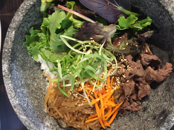 Classic Korean beef bulgogi is served in a stone pot with the usual accoutrements. - PHOTO BY EMILY MCCARTER