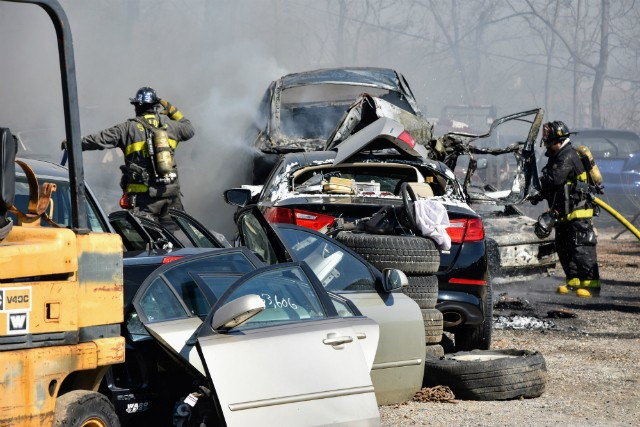 A car on a flatbed was torched along with surrounding vehicles, but firefighters put out the flames before they spread farther. - DOYLE MURPHY