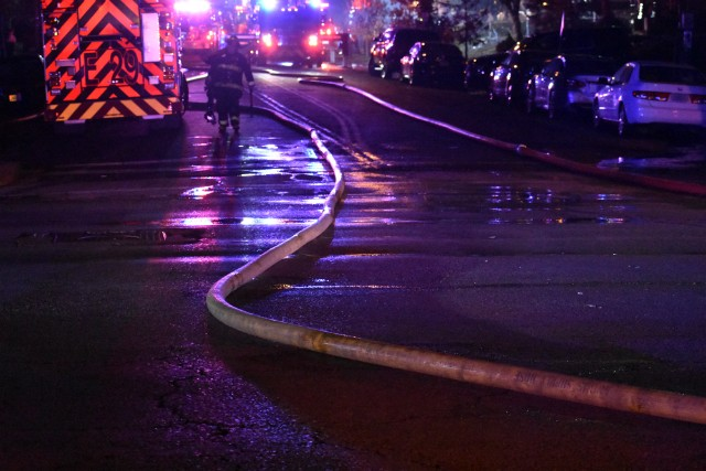 About 80 firefighters responded to the four-alarm blaze. - DOYLE MURPHY