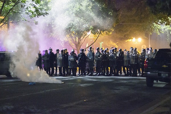 Police fired tear gas canisters into the streets of the Central West End on September 15, 2017. - DANNY WICENTOWSKI