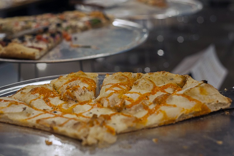 "Among the unique pizza options, the ""Flaming Lips"" features chicken, blue cheese dressing, wing sauce drizzle, white onion. - PHOTO BY KELLY GLUECK"