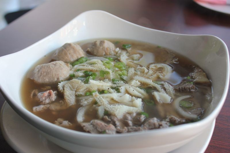 The pho dac biet features flavorful broth with a beef brisket meatball, soft tendon and a slice of filet mignon. - PHOTO BY SARAH FENSKE