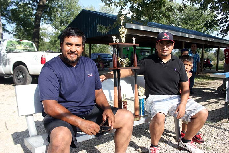 Oscar (left) and Alberto Pasadas run a Latino baseball league in St. Charles County. - PHOTO BY DOYLE MURPHY