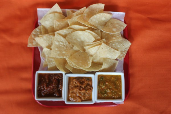 Chips with three kinds of salsa. - CHERYL BAEHR