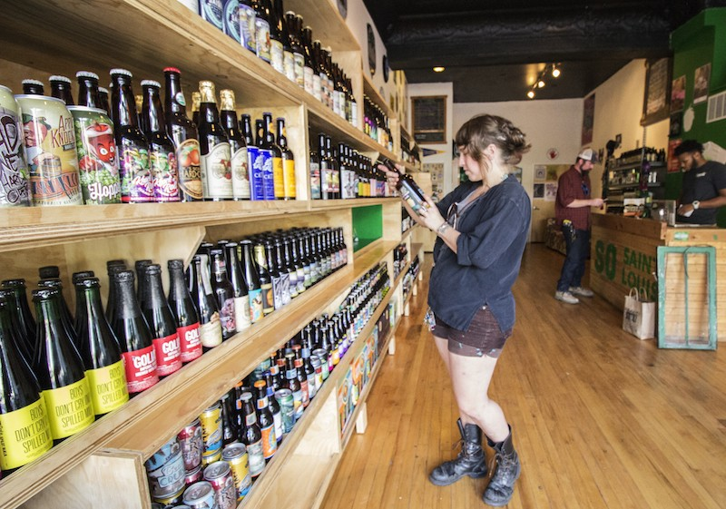 Nicole Casper browses the selection at Saint Louis Hop Shop. - PHOTO BY MABEL SUEN
