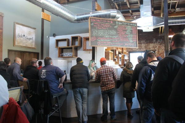 Side Project Brewing's tasting room opened to a packed house. - CHERYL BAEHR