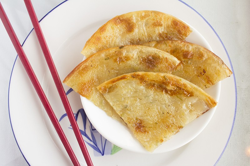 Scallion pancake: Flour dough, studded with scallions and pan-fried, then cut into triangles. - PHOTO BY MABEL SUEN