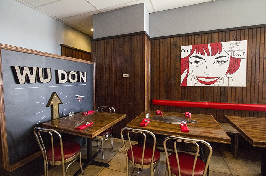 The handsome dining room features pop art. - PHOTO BY MABEL SUEN