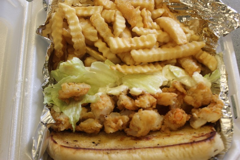 A shrimp po'boy is stuffed with hand-breaded shrimp and generously topped with mayo. - SARAH FENSKE