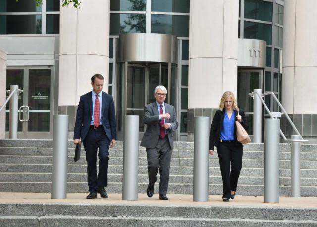 Assistant U.S. Attorney Hal Goldsmith (center) leaves the federal courthouse. - DOYLE MURPHY