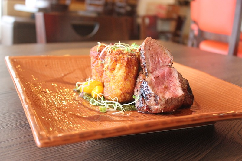The Prime 55 sirloin, served with cheddar tots and chimichurri. - SARAH FENSKE