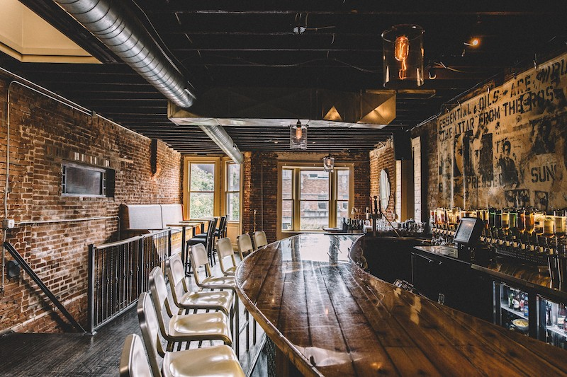 The upstairs bar at Brennan's — or, as they call it in Boston, Durango Cigars. - RJ HARTBECK