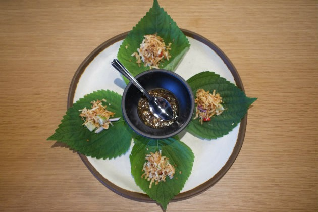 Mieng kham, made with dried shrimp, coconuts and fresh lime is one of the traditional appetizers served at Chao Baan. - CHERYL BAEHR