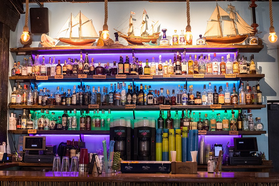 The bar is stocked with a legit rum selection for aficionados. - MABEL SUEN
