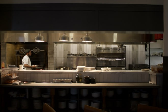 The open kitchen allows guests to have a peek at the action. - CHERY BAEHR