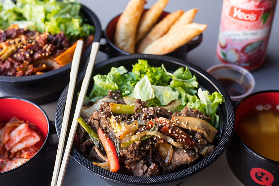 At BoBQ, the spicy pork bowl tops perfectly cooked rice with succulent and fiery sliced pork. - MABEL SUEN