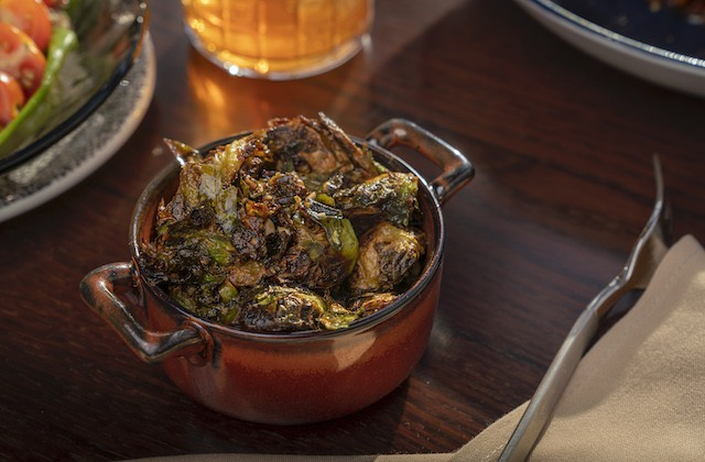 Brussels sprouts with sherry vinegar, lemon zest and marcona almonds. - COURTESY OF LODGING HOSPITALITY MANAGEMENT