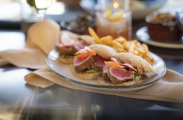 French onion steak sliders with horseradish cream, demi-glace, Gruyere and flash-fried arugula on caramelized onion rolls. - COURTESY OF LODGING HOSPITALITY MANAGEMENT