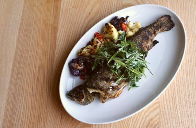 Grilled whole trout with herb salsa verde, grilled lemon, grilled cauliflower and pickled chiles. - LIZ MILLER