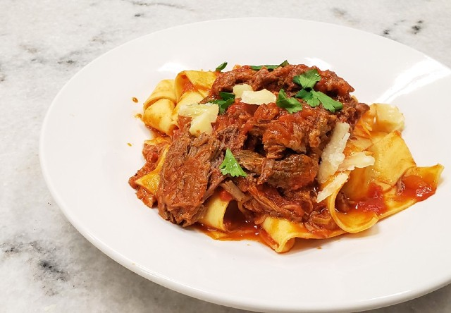 The pappardelle pasta is made with braised beef, tomato ragu and pecorino-romano cheese. - KRISTEN FARRAH