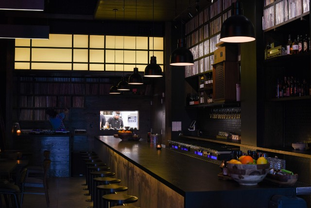 The massive bar at Takashima is bookended by the kitchen window and DJ booth on one side of the space. - TRENTON ALMGREN-DAVIS