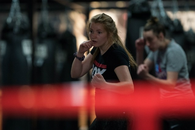 TITLE Boxing Club trainer Rachel Kearns leads workouts on a livestream, instead of meeting clients face to face. - TRENTON ALMGREN-DAVIS