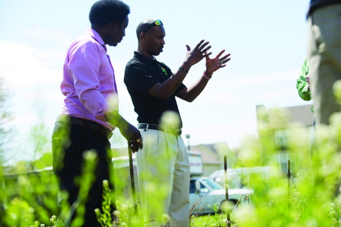 Pastor Paul Macharia and Geoffrey Soyiantet in the garden. - TRENTON ALMGREN-DAVIS