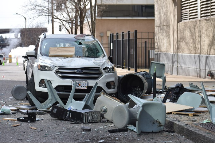 On the backside of the jail, debris thrown from the fourth floor landed on the street, sidewalk and and SUV. - DOYLE MURPHY