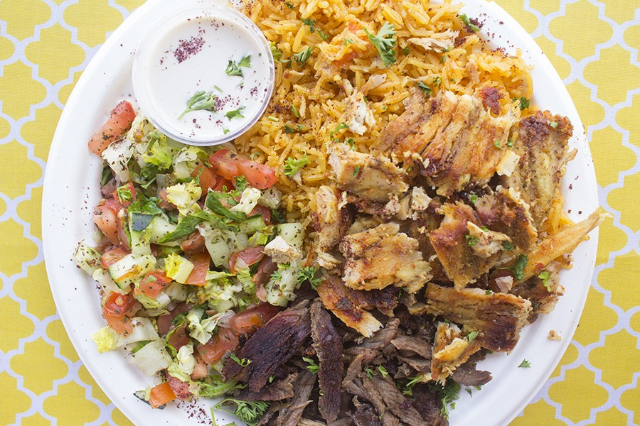 The mixed shawarma entree comes with rice, tahini sauce and Arabic salad. - MABEL SUEN