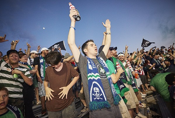 St. Louis soccer fans celebrate Saint Louis FC. The team's fan club supports Props 1 and 2, but the author — a big soccer fan — does not. - PHOTO BY STEVE TRUESDELL