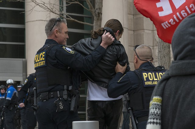 Police lead away a protester outside the St. Louis courthouse. - PHOTO BY NICK SCHNELLE