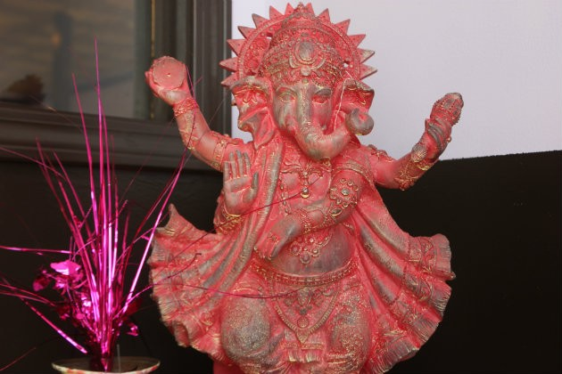 A statue of Ganesh greets diners at the front door. - CHERYL BAEHR